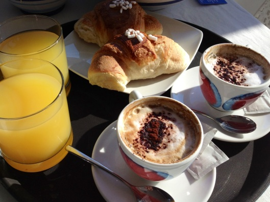 A classic Italian breakfast: cappuccino, orange juice and cornettis, the pastries can plain or filled with nutella, marmalade or chocolate.