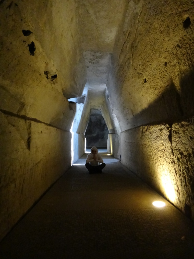 The Sibyl's cave: according to the myth, this was where to find the Cumaean Sibyl; the oracle consulted by Aeneas.  The tufa passage way, trapezoid in section is naturally illuminated by narrow fissures and ends in a vaulted chamber.  The system connects Cumae to lake Averno.