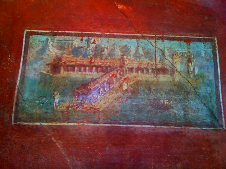 Wealthy residents in Pompeii had often well decorated walls like this one found in the House of The Vettii.