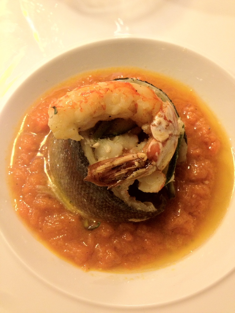 Sea Bass on a bed of spice pumpkin sauce topped with a grilled prawn at Signum Cubo Restaurant in Vico Equense.