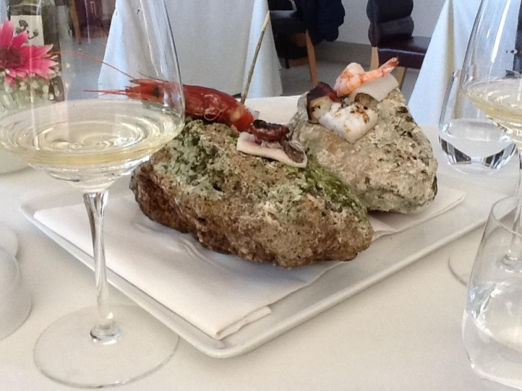 Local caught treasures of the sea naturally steamed on a base of hot stones well paired with Scala Fenicia wine of Capri