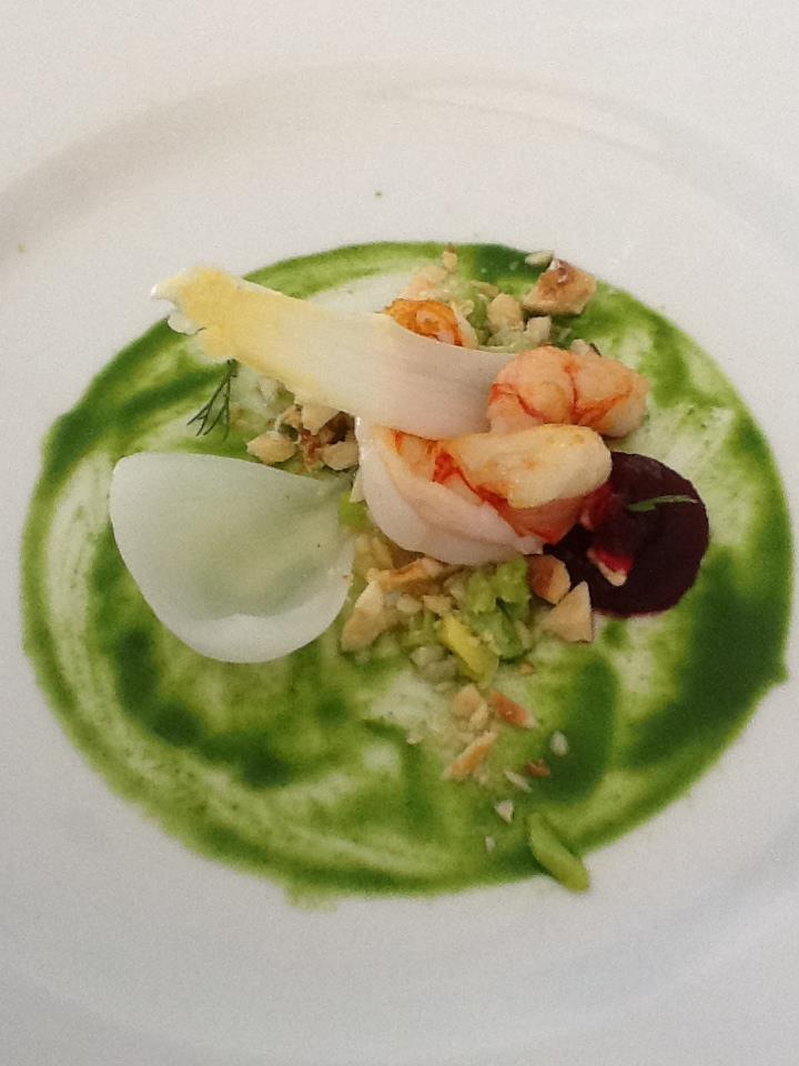 The pistachio and herb aromatic bed for the prawns, crusted nuts and beet sauce on the side