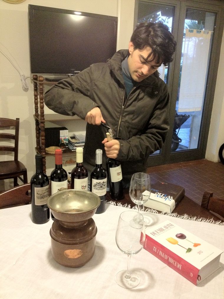 Vincenzo di Meo, young enologist in charge of the family owned winery La Sibilla conducting a wine tasting of his own production.