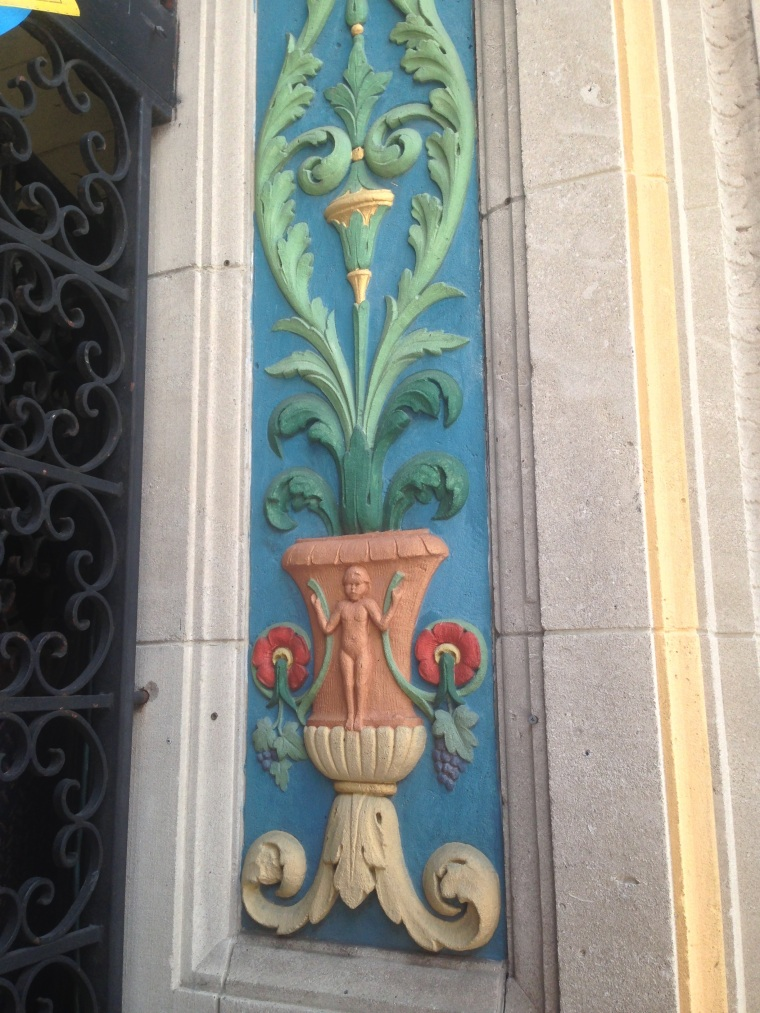 Detail on the entrance of Soya & Pomodoro restaurant.  The Shoreland Arcade Building is part of the National Register of Historic Places