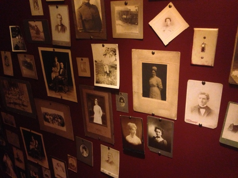 Vintage pictures and postcards on the wall going downstairs to the cellar at Le Chat Noir for live jazz.  You can order also appetizers and wine at the Bar while listening to the finest jazz music.